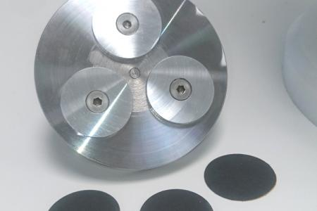 Support pour essai d'abrasion et disques abrasifs
